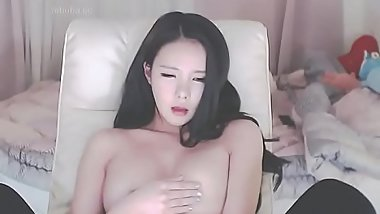 Hot Korean plays with ber boobs masturbating